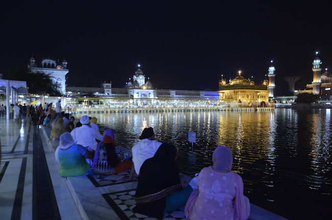 India- Amritsar- golden temple people and lights
